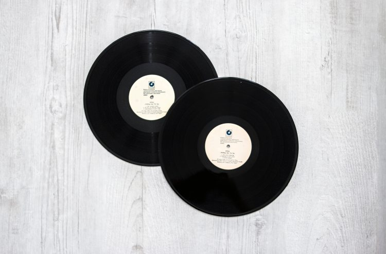 photography-of-vinyl-records-on-wooden-surace-1021876